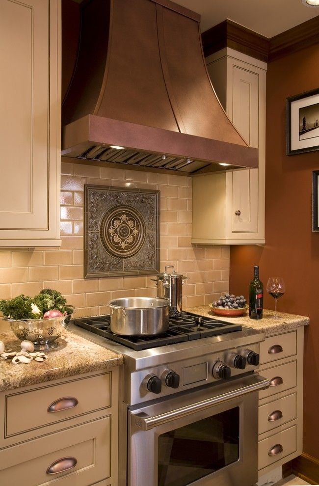 Jemco for a Traditional Kitchen with a Tile Backsplash and English Tudor Kitchen by Robin Rigby Fisher Cmkbd/caps