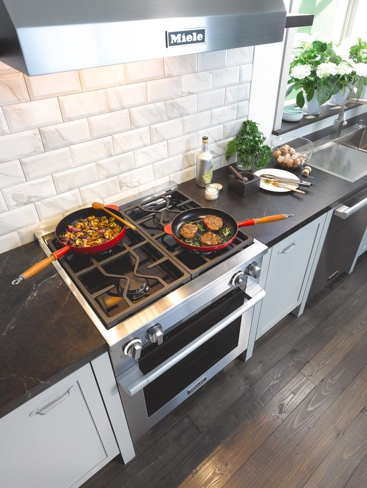 Jennifer Convertible for a Contemporary Kitchen with a Dark Wood Flooring and Miele by Miele Appliance Inc