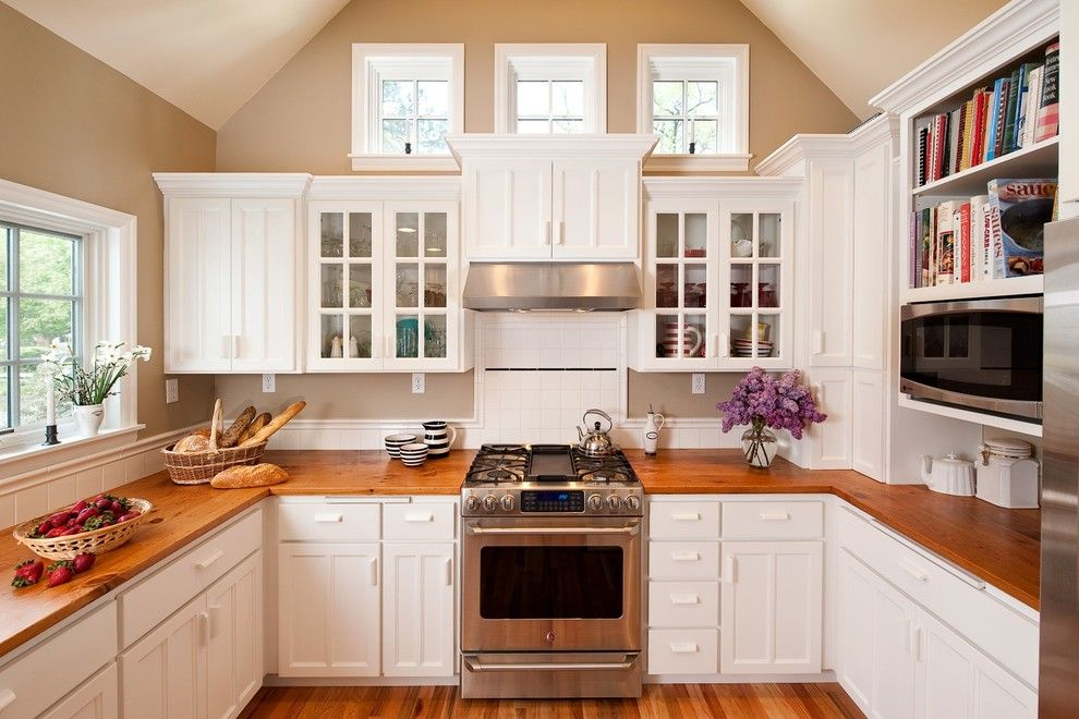 Johns Appliance for a Traditional Kitchen with a White Tile Backsplash and Cape Cod Kitchen by Powell Construction