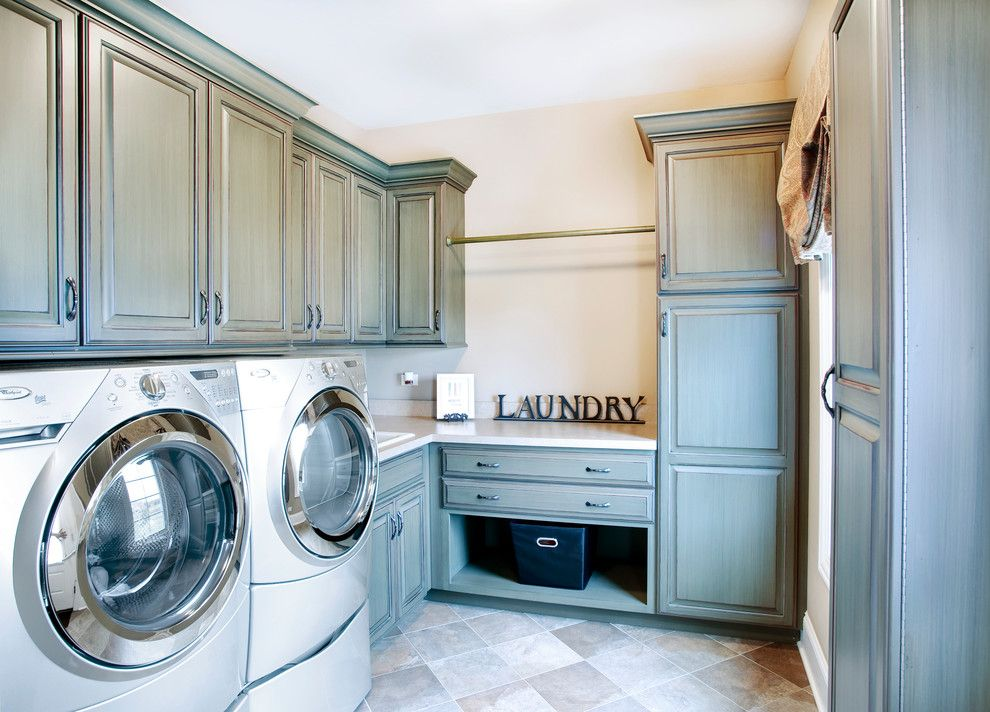 Johns Appliance for a Traditional Laundry Room with a Beige Countertop and Custom Residence in the Reserve of St. Charles by John Hall Custom Homes