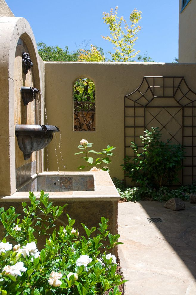 Jolee for a Mediterranean Landscape with a Stucco and Exteriors by Harrell Remodeling, Inc.