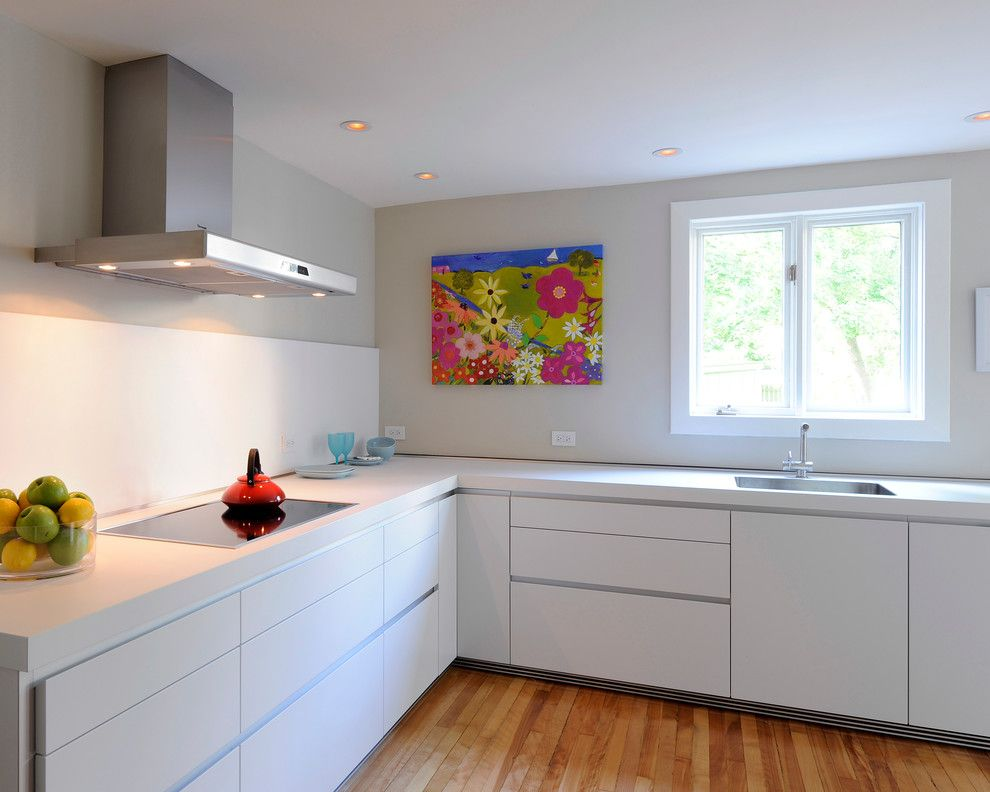 Kamco Building Supply for a Modern Kitchen with a Red Teapot and Mackay House by Denys Builds Designs
