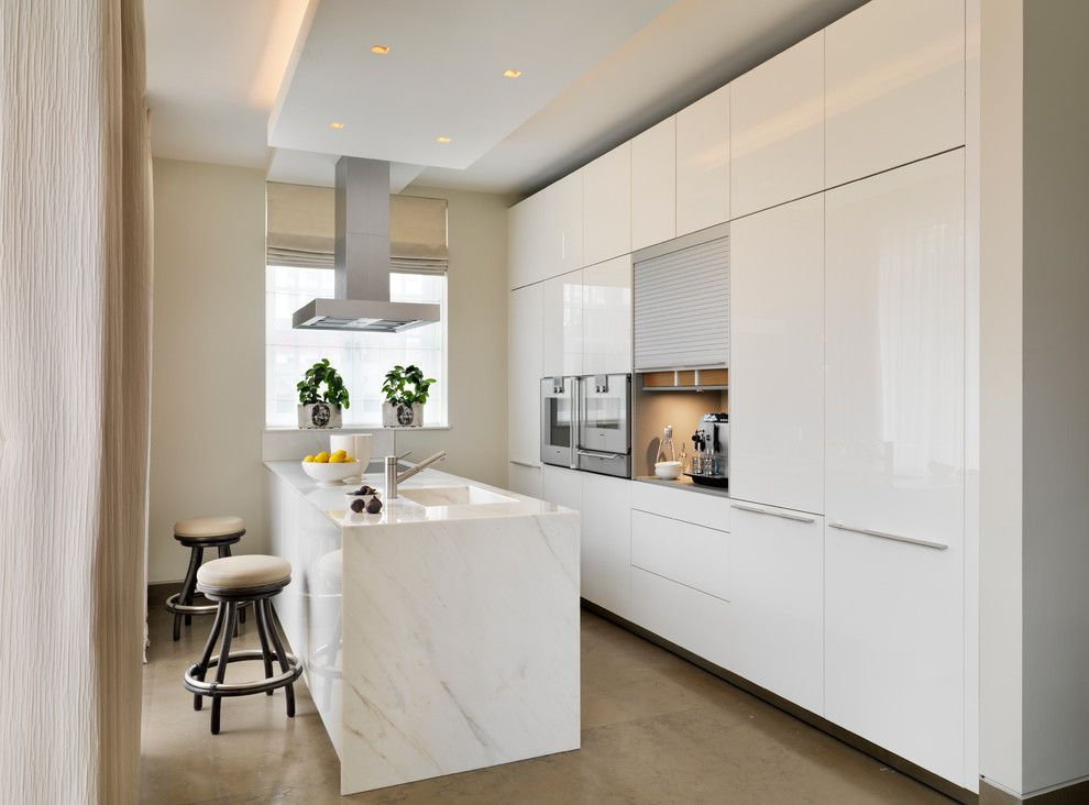 Kettle Moraine Appliance for a Contemporary Kitchen with a Beige Floor Tile and Luxury Apartment by Bulthaup by Kitchen Architecture
