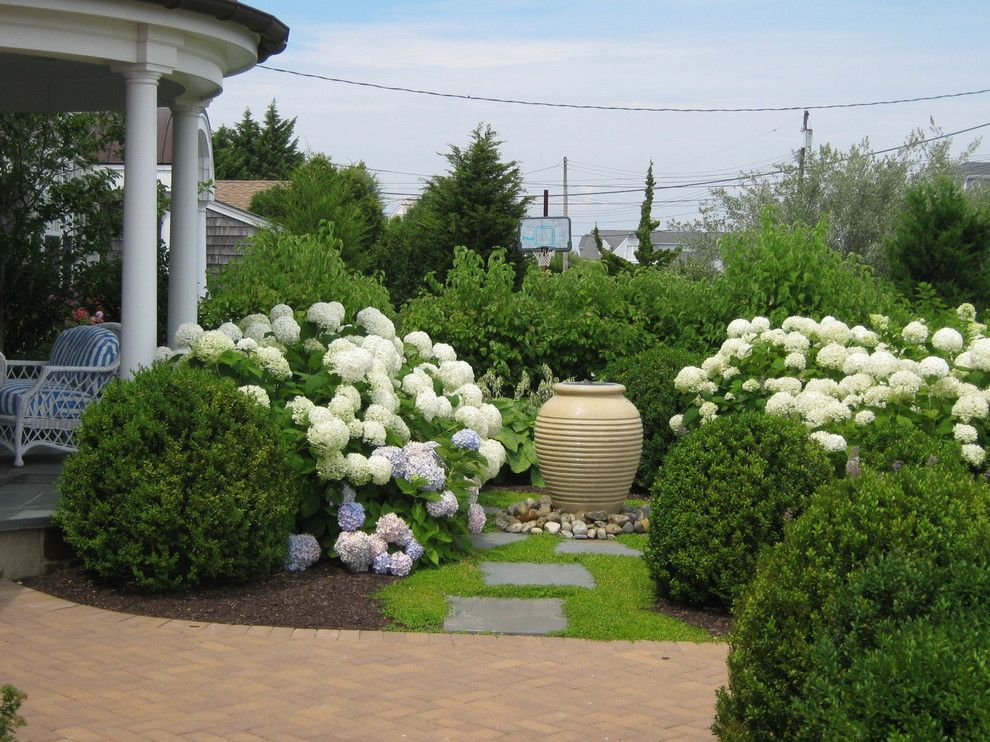 Kettle River Furniture for a Beach Style Landscape with a White Flowers and Shore Residence by Cross River Design, Inc.