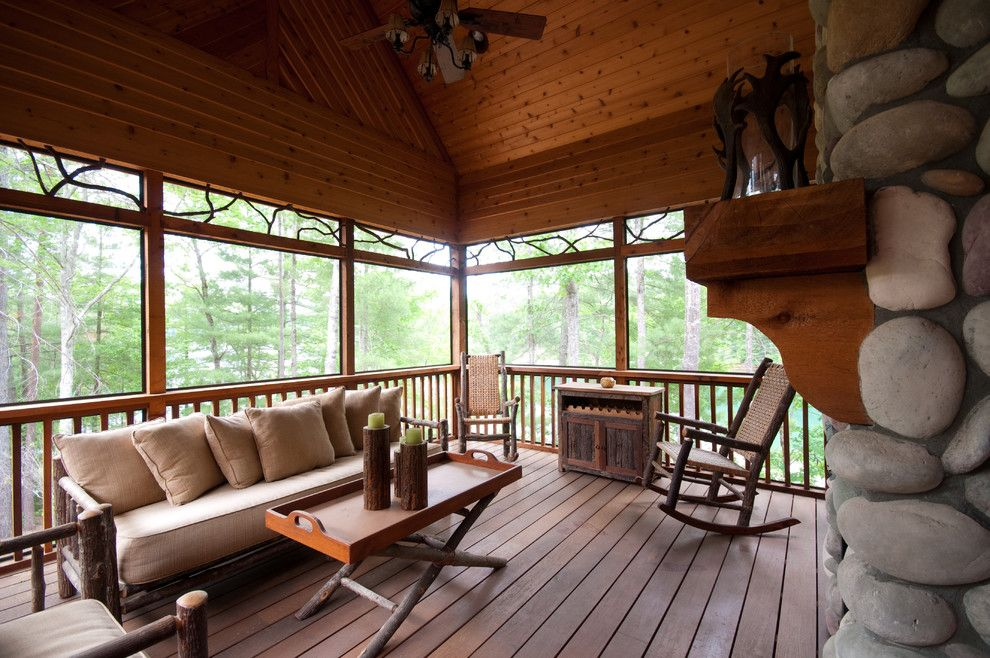 Kettle River Furniture for a Rustic Deck with a Ceiling Fan and Outdoor Space by Hillcrest Home of Keowee Inc.
