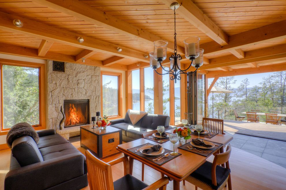 Kettle River Furniture for a Rustic Family Room with a Wood Ceiling and Good Things Come in Small Packages by Kettle River Timberworks Ltd.