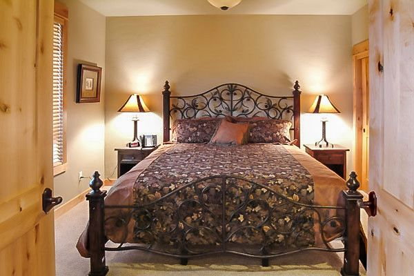 King Ranch Turfgrass for a Farmhouse Bedroom with a Wrought Iron and Brasada Ranch Resort – Rimrock 1 Story Cabin with Lock Offs (For Rental) by Western Design International