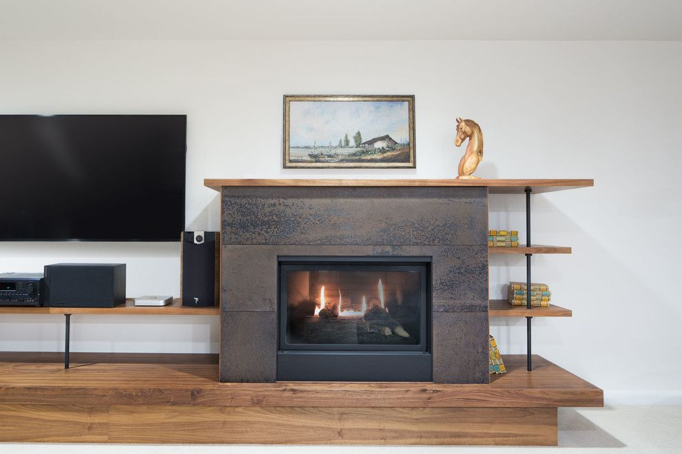 Kingsman Fireplace for a Modern Living Room with a Smith and Valle Woodworks and Modern Remodel by Chuckanut Builders