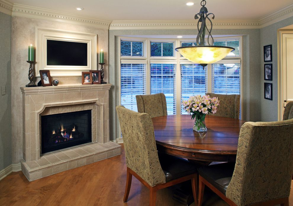 Kitchen Table Omaha for a Traditional Dining Room with a Mantle and Project 'Thirty' by Cramer Kreski Designs