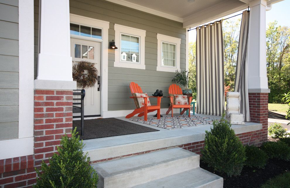 Koehler Home Decor for a Craftsman Porch with a Area Rug and Trailside:  Picturesque Porch by Everything Home