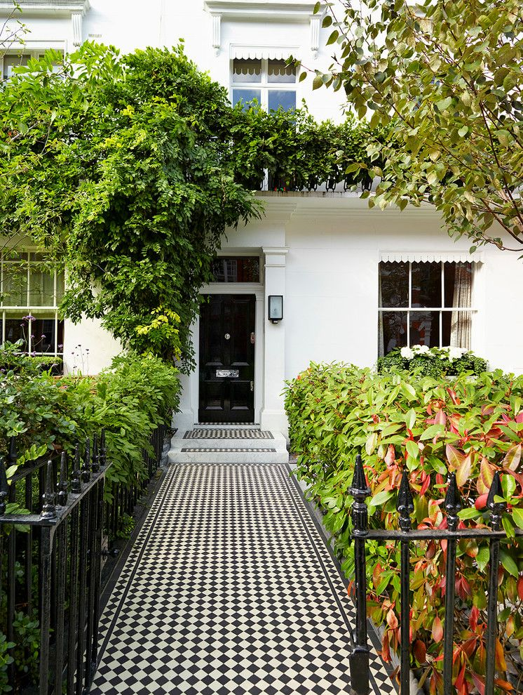 Koehler Home Decor for a Traditional Entry with a Black Front Door and Holland Park House Renovation by Tylermandic Ltd