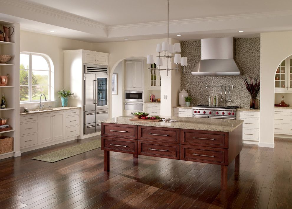 Koehler Home Decor for a Traditional Kitchen with a Chandelier and Kitchens by Sub Zero and Wolf
