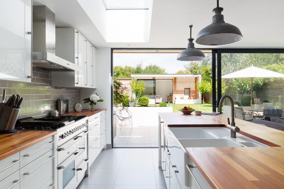 Koit for a Contemporary Kitchen with a Gray Floor Tile and Contemporary Kitchen by Granit Chartered Architects