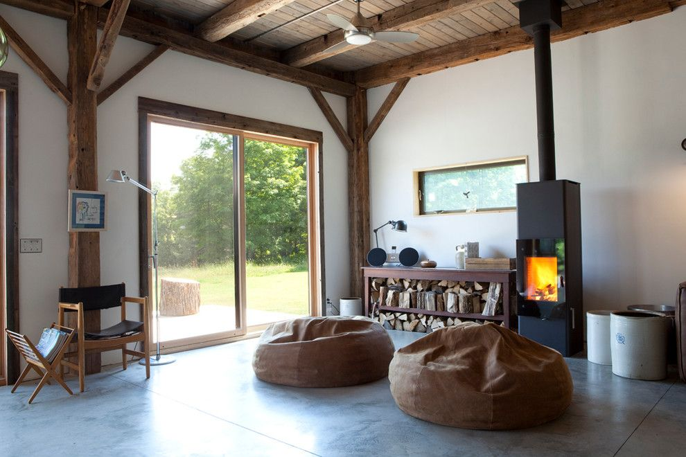 Koit for a Rustic Living Room with a Sliding Glass Doors and Bovina House by Kimberly Peck Architect