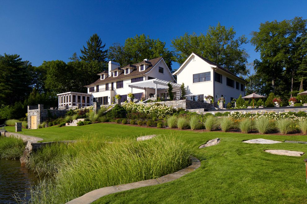Lake Winnipesaukee Real Estate for a Transitional Exterior with a Lake Front and Greenwich Residence by LEAP Architecture