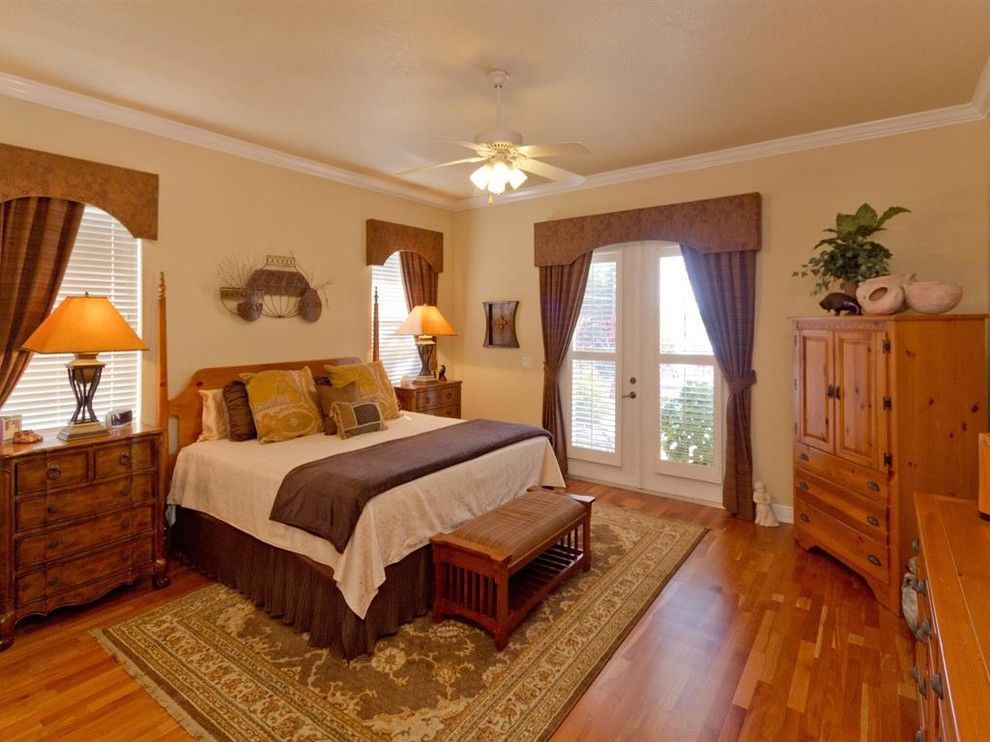Lanai Definition for a Traditional Bedroom with a Yellow Exterior and Custom Lakefront   Johns Cove Lane by J&j Building