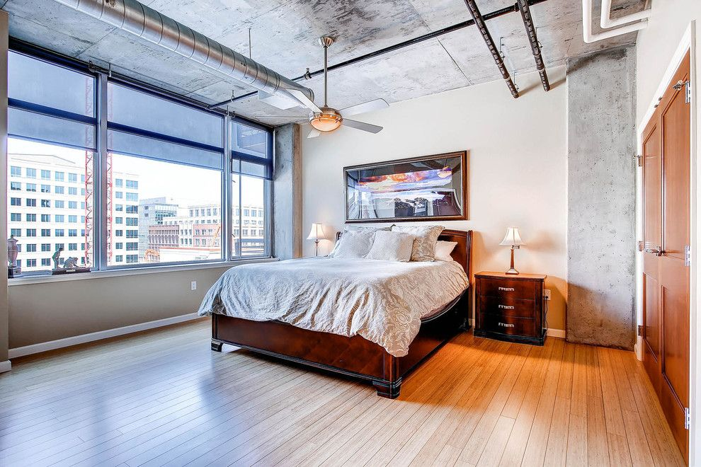 Larchmont Real Estate for a Industrial Bedroom with a Bed and Master Bedroom: 1401 Wewatta Street #718 by Porchlight Real Estate Group