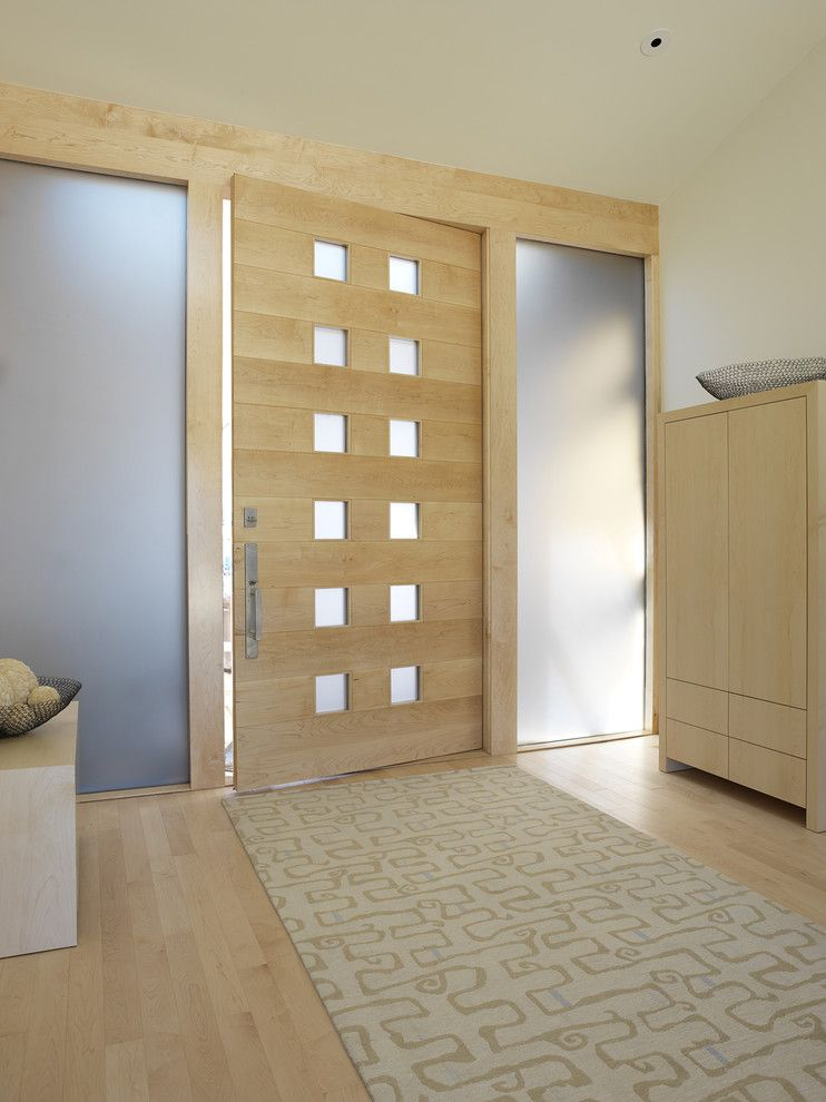 Larsondoors.com for a Contemporary Entry with a Wood Door and