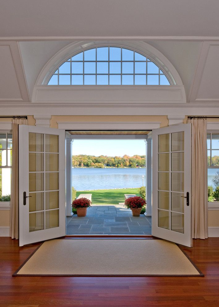 Larsondoors.com for a Traditional Entry with a Radius Window and From Kids to Quiet by Siemasko + Verbridge