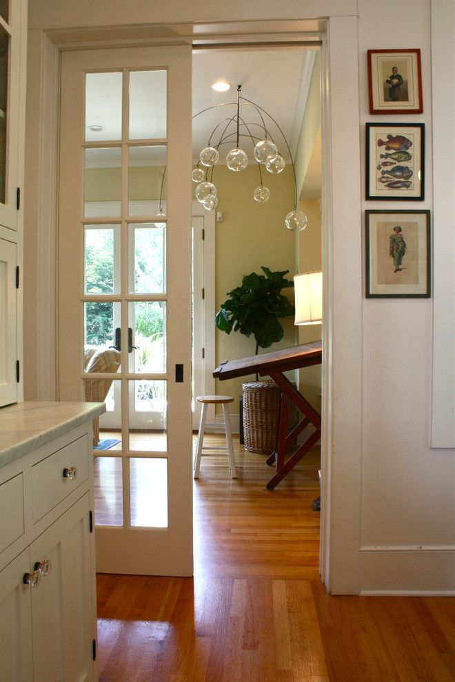 Larsondoors.com for a Traditional Hall with a Door Casing and Family Room by Shannon Malone