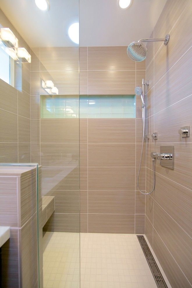 Laying Ceramic Tile for a Contemporary Bathroom with a Beige Tile Shower and Contemporary Shower by Spaces Renewed