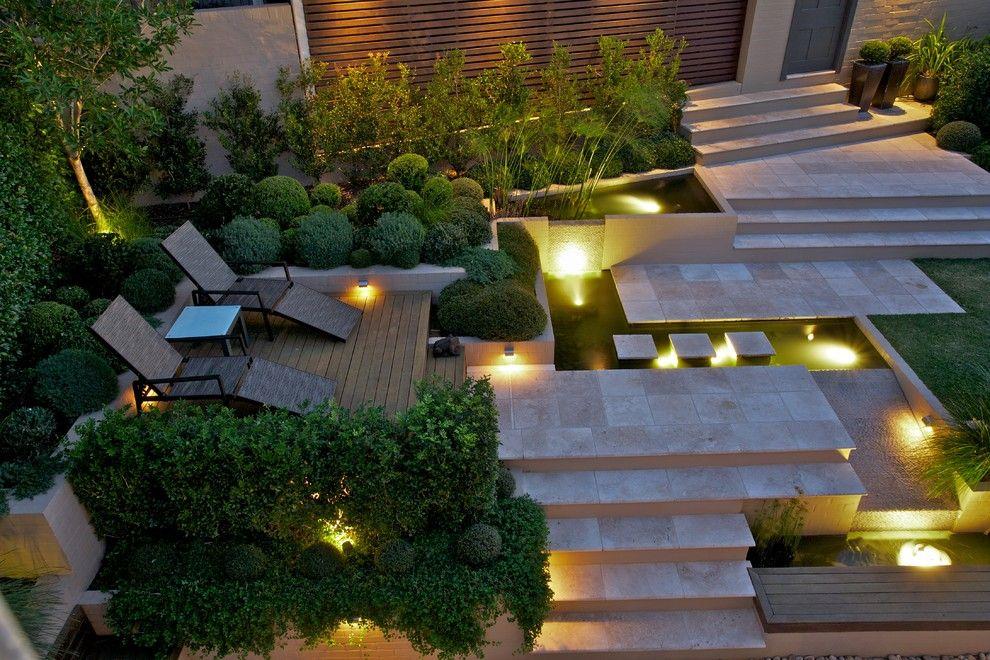Laying Pavers for a Contemporary Landscape with a Aquatic and Northbridge by Art in Green