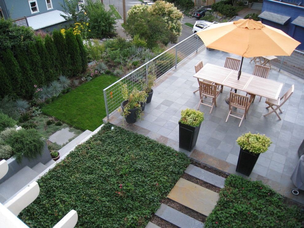 Laying Pavers for a Contemporary Landscape with a Patio Furniture and Two Rooms by Modernbackyard