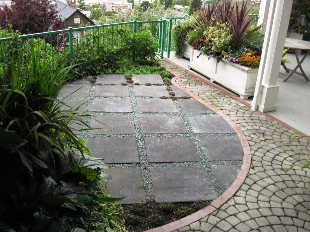 Laying Pavers for a Eclectic Patio with a Planter Boxes and Eclectic Patio by Cambiumlandscape.com