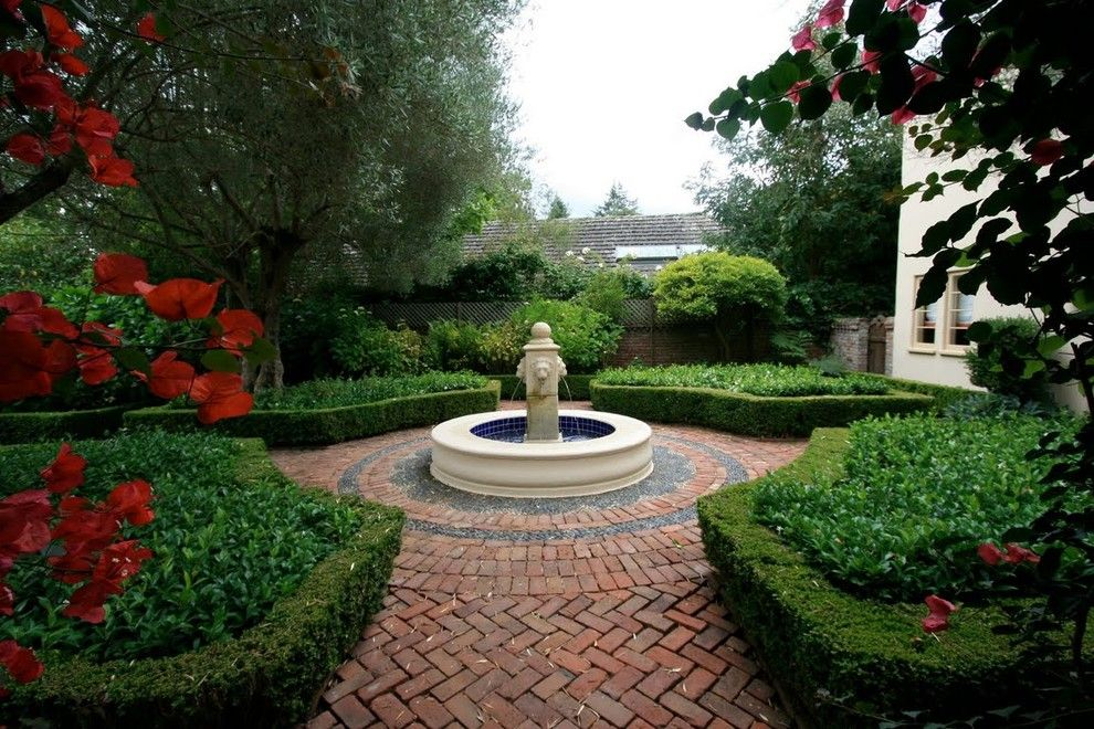 Laying Pavers for a Mediterranean Landscape with a Fountain and Mediterranean Retreat in Palo Alto by Houzz.com