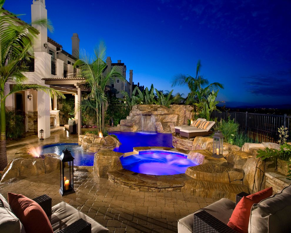 Laying Pavers for a Mediterranean Pool with a Rock Water Feature and Orange County Projects by Alderete Pools & Solar