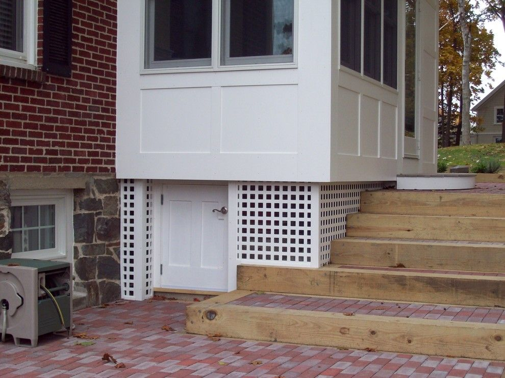 Laying Pavers for a Traditional Exterior with a Pavers and Sunroom Addition with Exterior Storage by O'shea Builders Llc.