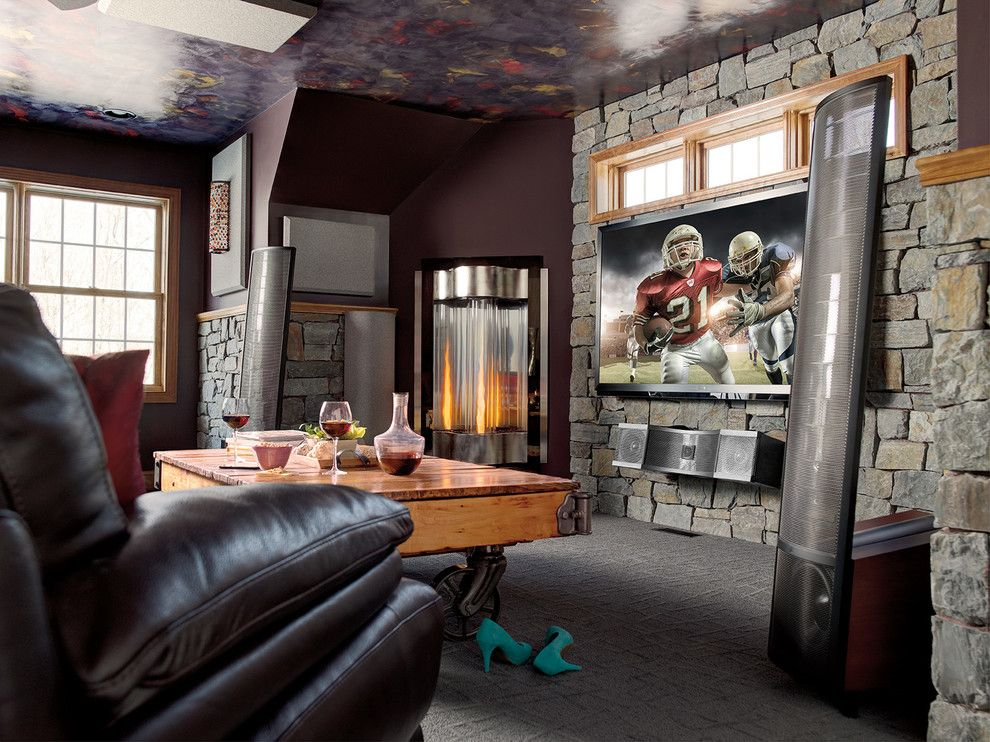 Lees Summit Honda for a Craftsman Home Theater with a Fireplace and Home Theater by Magnolia Design Center