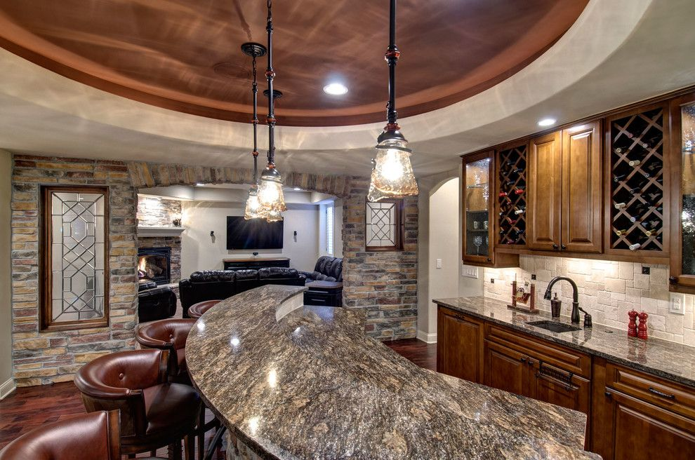 Leland Furniture for a Traditional Wine Cellar with a Architectural Details and Basement Wet Bar Countertop by Finished Basement Company