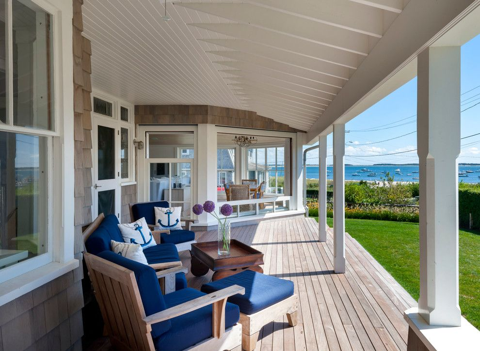 Levin Furniture Locations for a Beach Style Porch with a Cape Cod Style and Cape House by Curl Simitis Architecture+Design