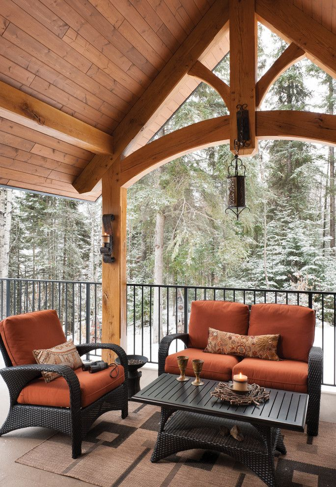 Levin Furniture Locations for a Rustic Deck with a Riverbend and Mountain Timber Frame Home in Canada by Riverbend Timber Framing