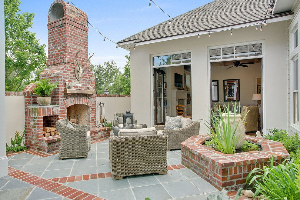 Levin Furniture Locations for a Traditional Patio with a Brick Fireplace and Private Courtyard by Highland Homes, Inc.