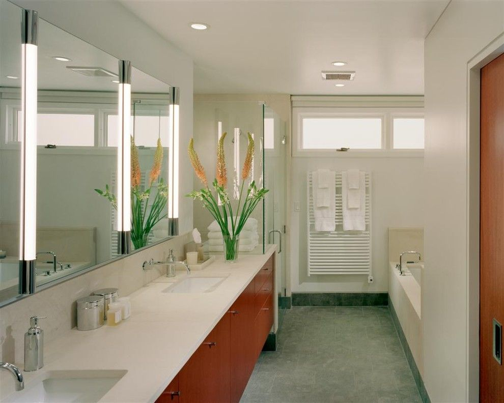 Light Bulb Depot for a Modern Bathroom with a Towel Warmer and Queen Village Residence Master Suite Bathroom by Hanson Fine Building