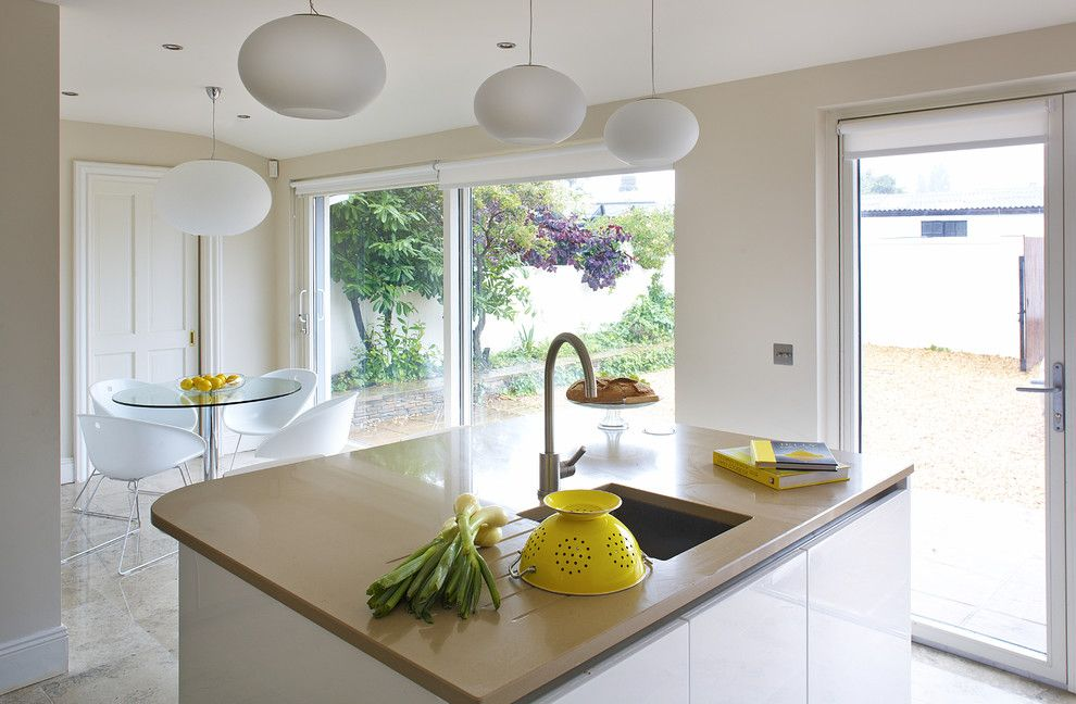 Lightbright for a Contemporary Kitchen with a Kitchen Island and Bright and Clean Kitchen with a Hint of Yellow by Optimise Design