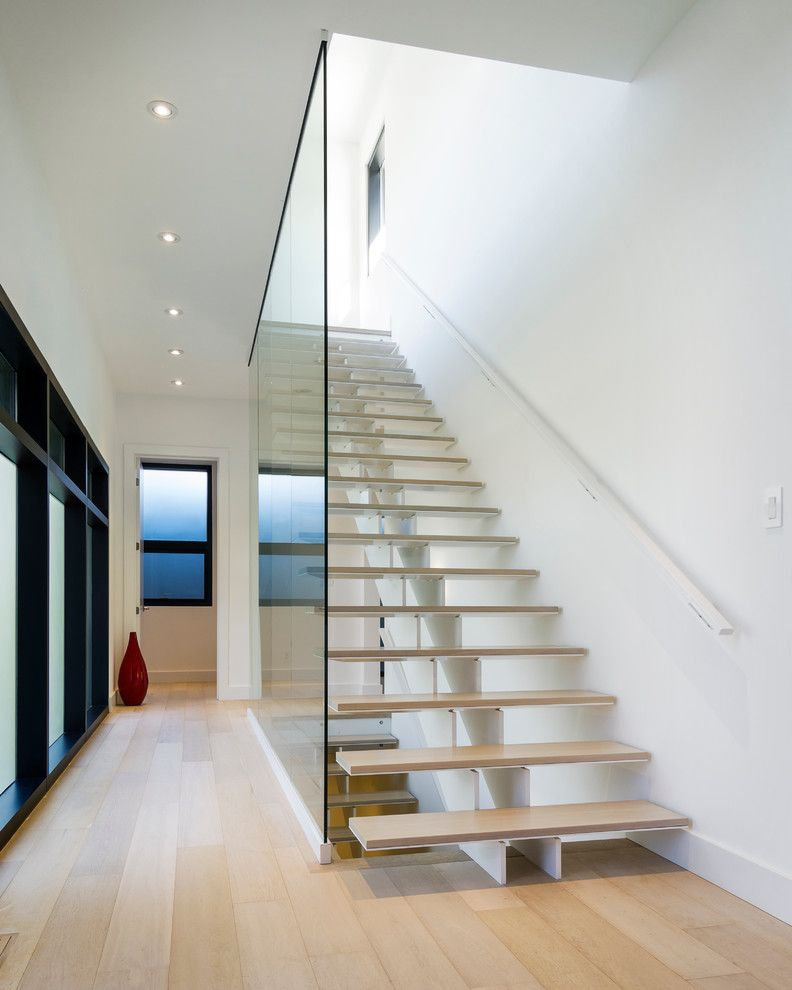 Lightbright for a Modern Staircase with a Carrothers and Associates and Grey House by Carrothers and Associates Inc.
