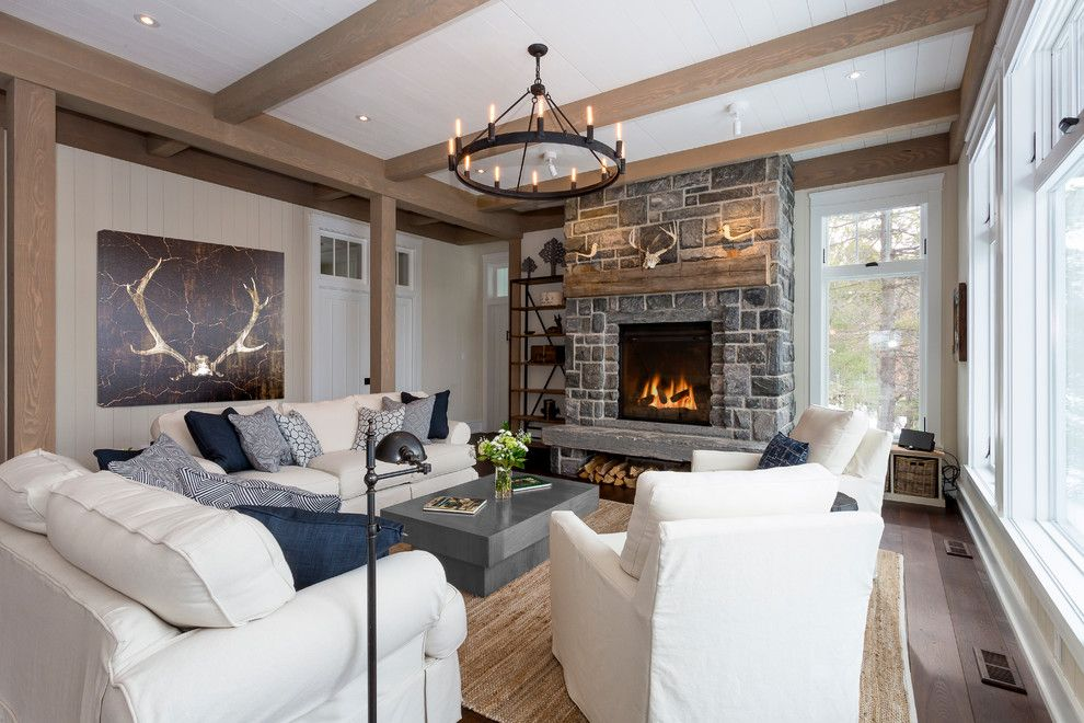 Lightbright for a Rustic Living Room with a Wood Mantel and East Bay Cottage, Lake Muskoka by Sprout Studios