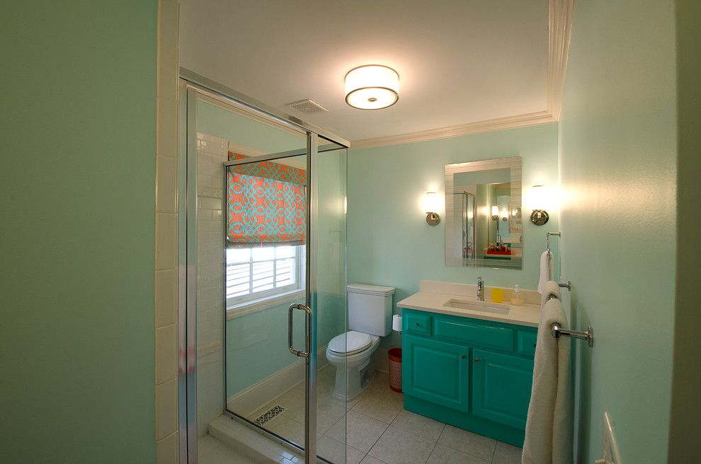 Lilly Pulitzer Designs for a Traditional Bathroom with a Lacquer and Vibrant Home in Budleigh by Sigmon Construction