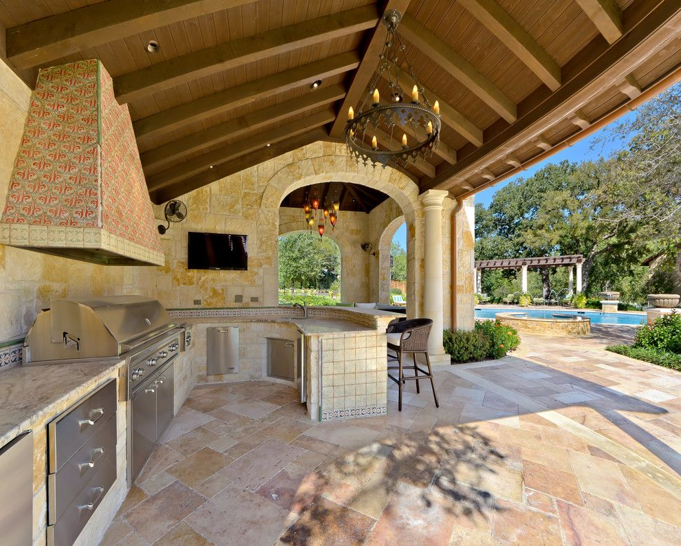Limestone Grill for a Mediterranean Patio with a Covered and Private Residence - Mediterranean Style Estate by Harold Leidner Landscape Architects
