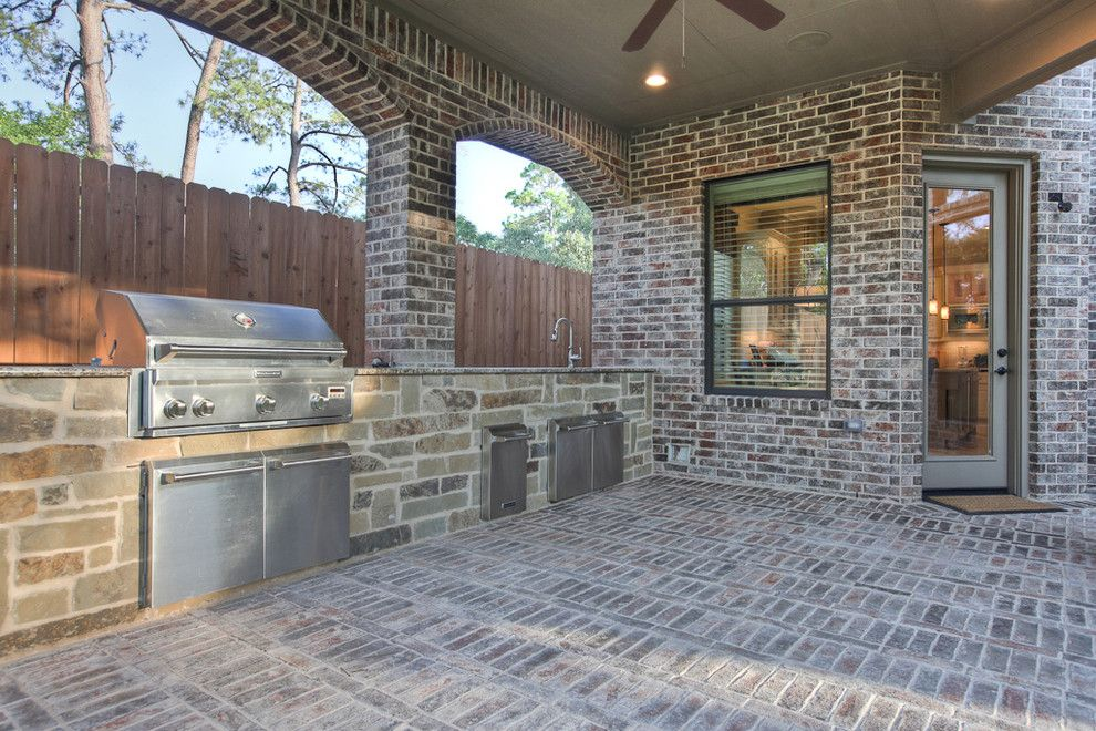 Limestone Grill for a Traditional Patio with a Ceiling Fan and Traditional Patio by Silvanhomes.com