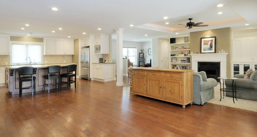 Linon for a Traditional Family Room with a Wood Floor and Ranch Style Dressing by Morse Custom Homes and Remodeling
