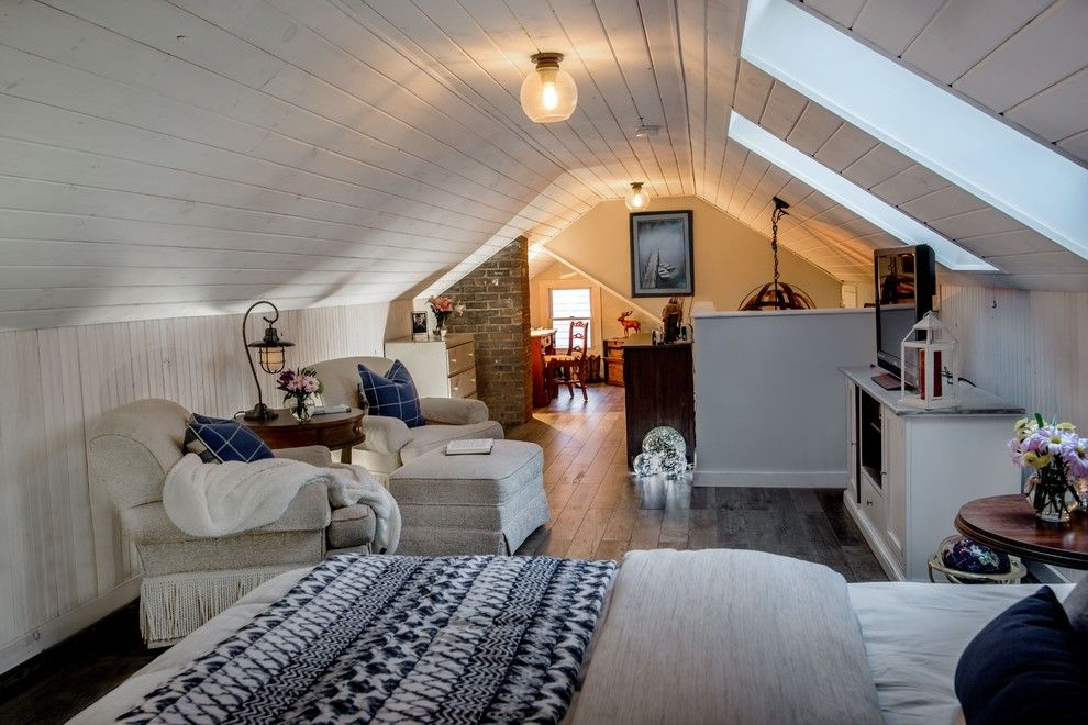Lofting for a Transitional Spaces with a White Washed Ship Lap and Loft Bedroom by a Perfect Placement