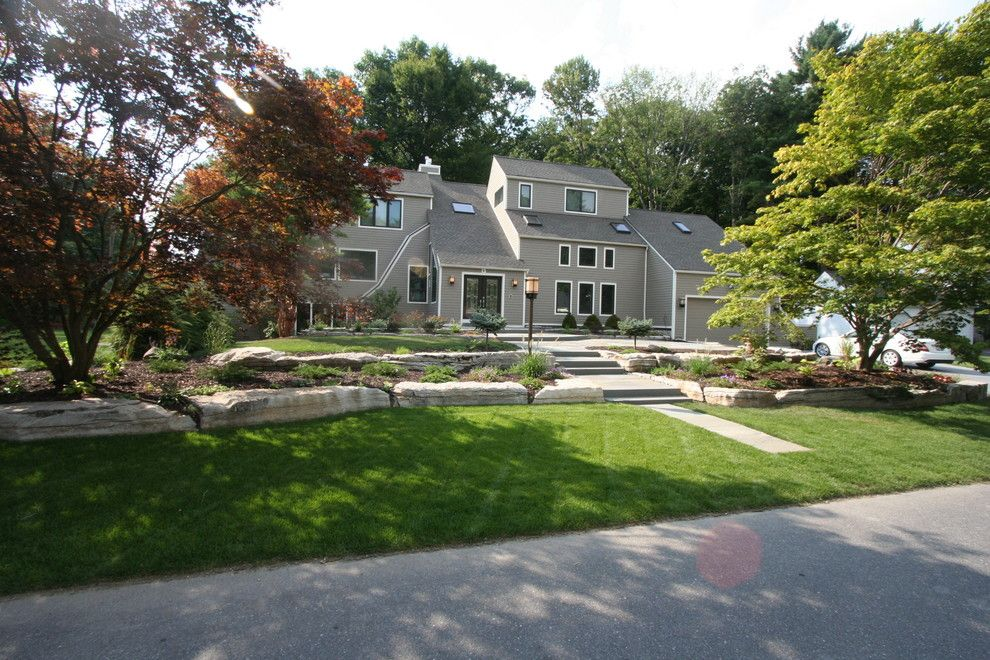 Longview Lawn and Garden for a Contemporary Landscape with a Front Yard Garden and Boulder Walls, Bluestone Patios and Plantings by Perennial Landscaping