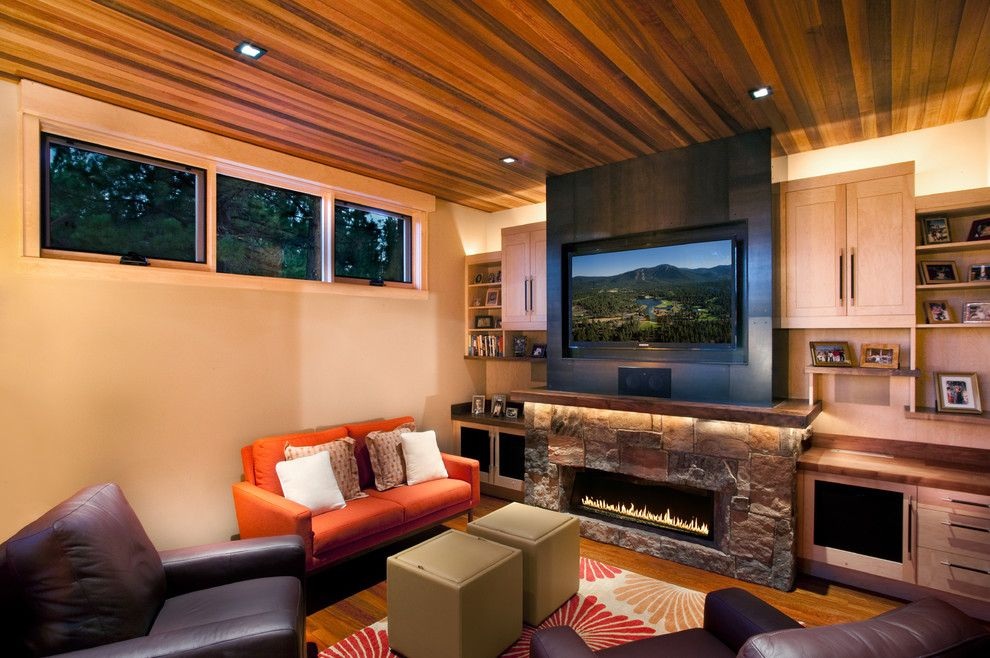 Lowes Alexandria La for a Contemporary Family Room with a Stone Fireplace Surround and Family Room by Ryan Group Architects