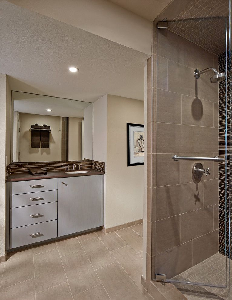 Lowes Dallas for a Contemporary Bathroom with a Tile Backsplash and Guest Bathroom Remodel by Blackline Renovations