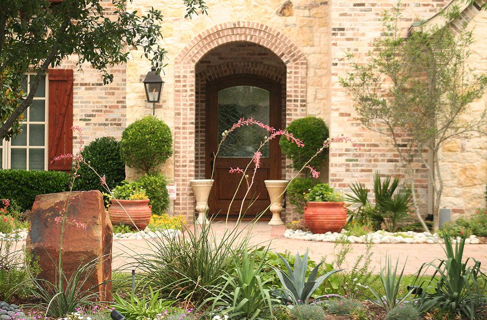 Lowes Dallas for a Traditional Landscape with a Brick Arch and Water Efficient Landscape Renovation by Verdant Grounds