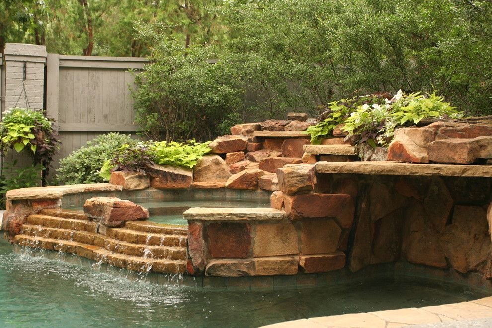 Lowes Dallas for a Transitional Landscape with a Hot Tub and Lush Backyard Landscape with Pool by Verdant Grounds